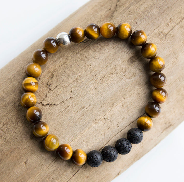 Beautiful 8mm tiger's eye semi-precious stone blessing bracelet featuring 4 lava stones and your choice of essential oils for love, protection, grounding and/or grief; adorned with sterling silver ball bead and charm, stretch, measures 20.3 cm
