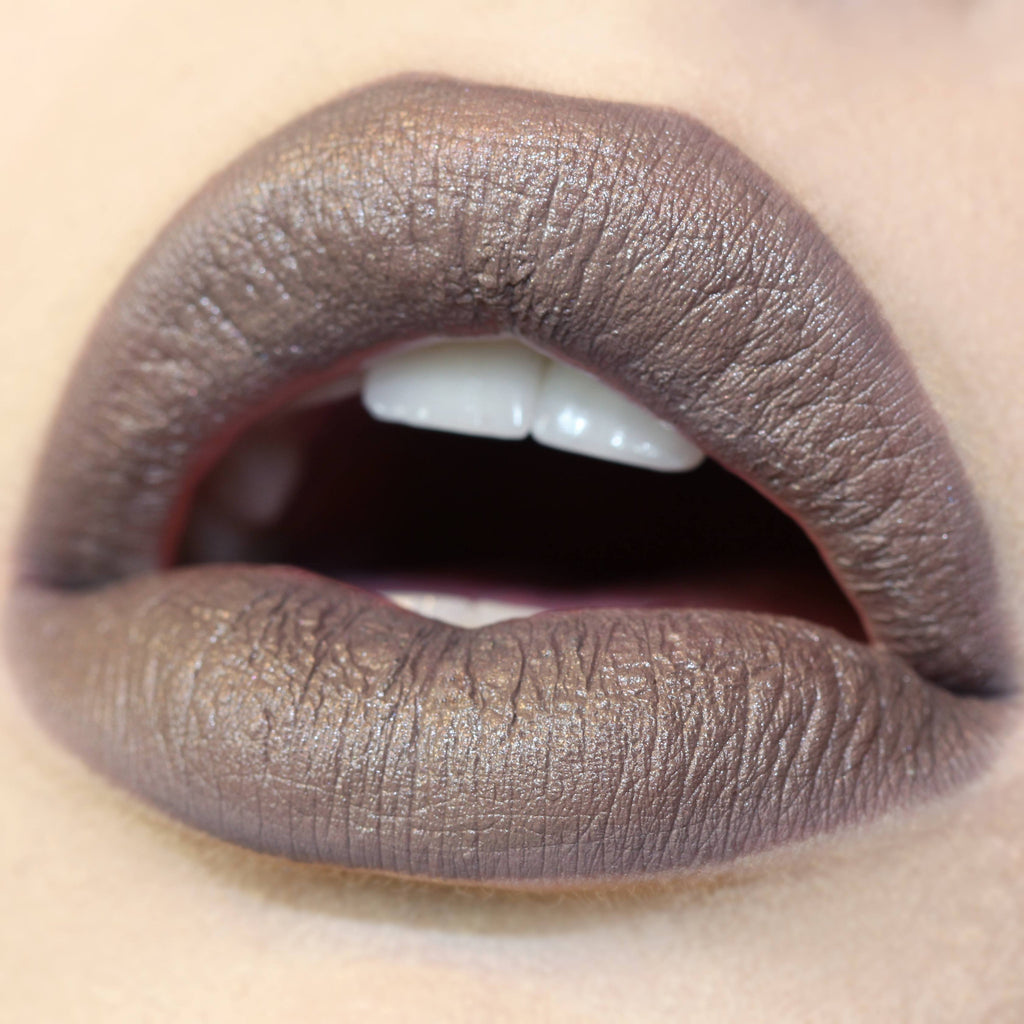 Wet pearlized taupe Lippie Stix swatch