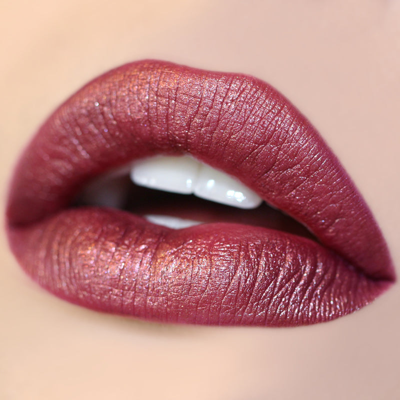 plum metallic with gold sparkles lip swatch