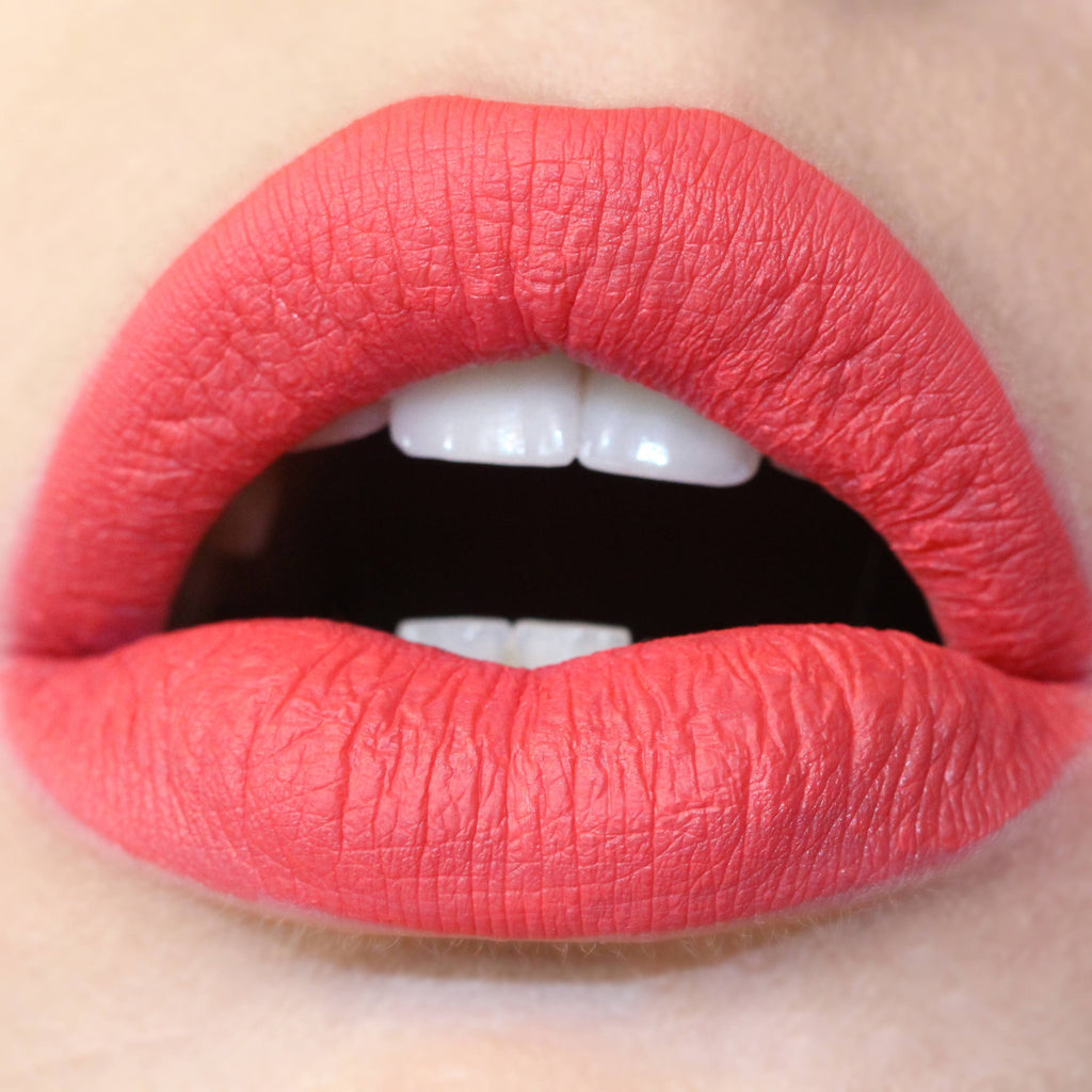 Ouiji bright coral Ultra Matte Lip swatch