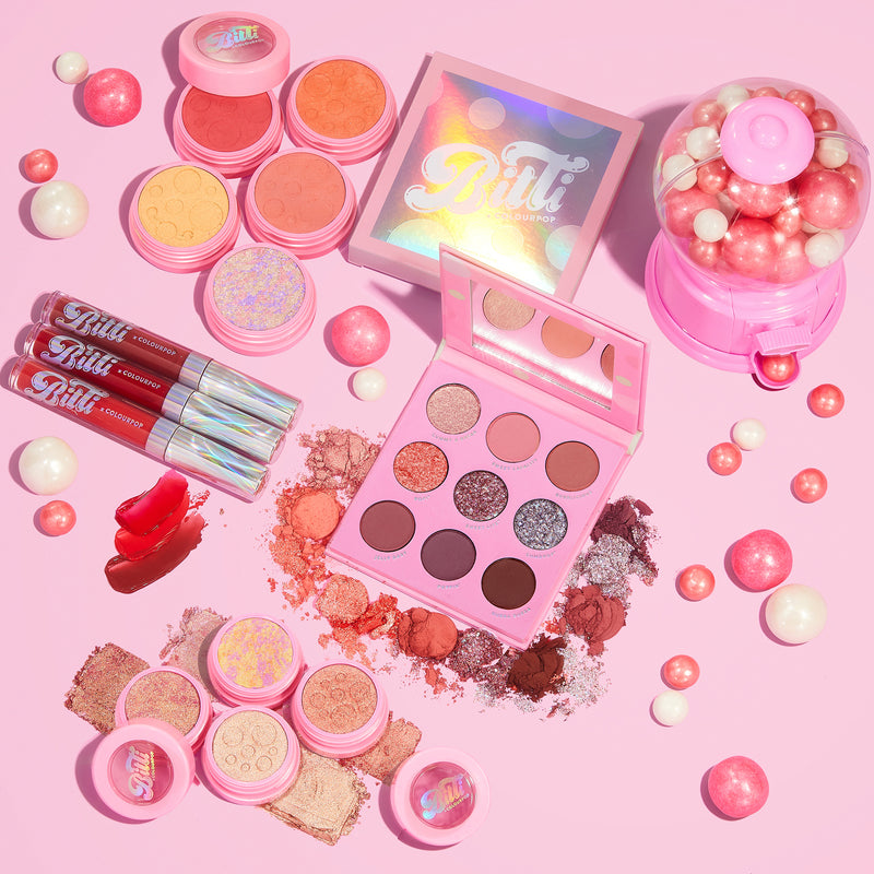 Bitti x ColourPop PR Box Collection Includes the Candy Button Palette, Bitti Pop Super Shock Shadow Foursome, Sweetener Liquid Lip Trio, and all 4 Super Shock Cheeks stylized photo with gum balls!