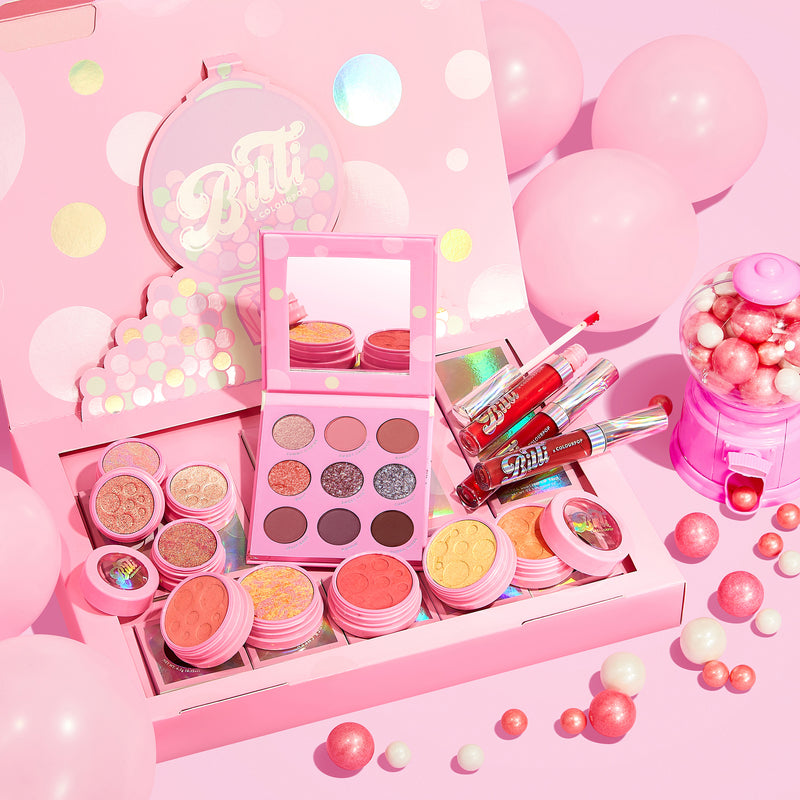 Bitti x ColourPop PR Box Collection Includes the Candy Button Palette, Bitti Pop Super Shock Shadow Foursome, Sweetener Liquid Lip Trio, and all 4 Super Shock Cheeks stylized photo with gum balls.