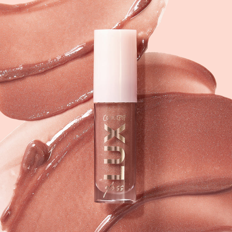 Come Thru lux liquid gloss with warm terracotta with pinpoints of silver and with pearlized finish