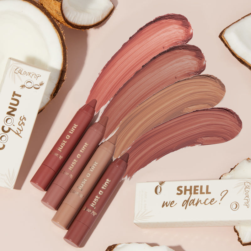 Shell We Dance? a sheer pinky nude and mahogany lip tint duo stylized photo with coconuts and product swatches