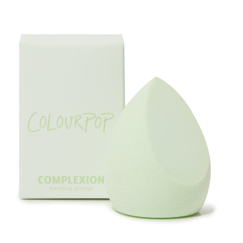 Complexion Blending Sponge next to its unit carton