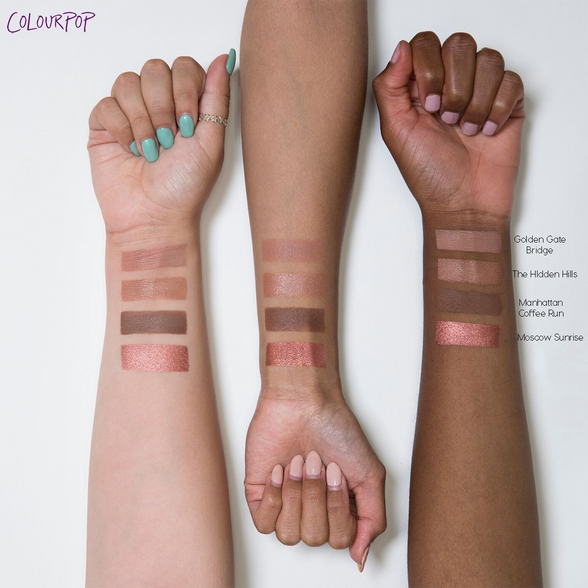 Sonya Esman x ColourPop - Gemini by Night includes Golden Gate Bridge matte warm nude, The Hidden Hills satin warm taupe, Manhattan Coffee Run matte mid-tone brown, and Moscow Sunrise metallic rosy copper Pressed Powder eye Shadows arm swatches