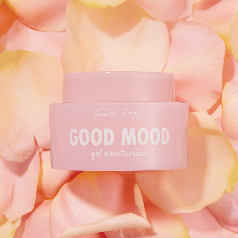 Good Mood gel moisturizer , in front of pink rose petals