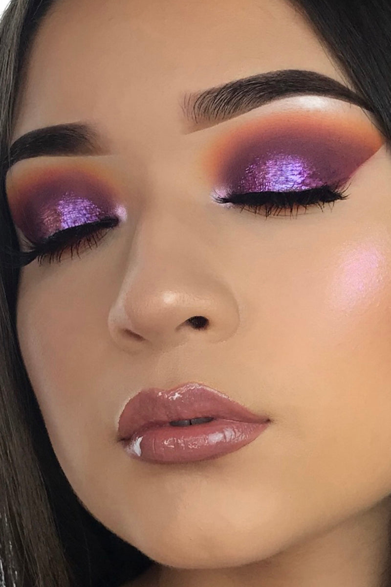 My Forte lavender with a green flip Ultra Glossy Lip gloss on model