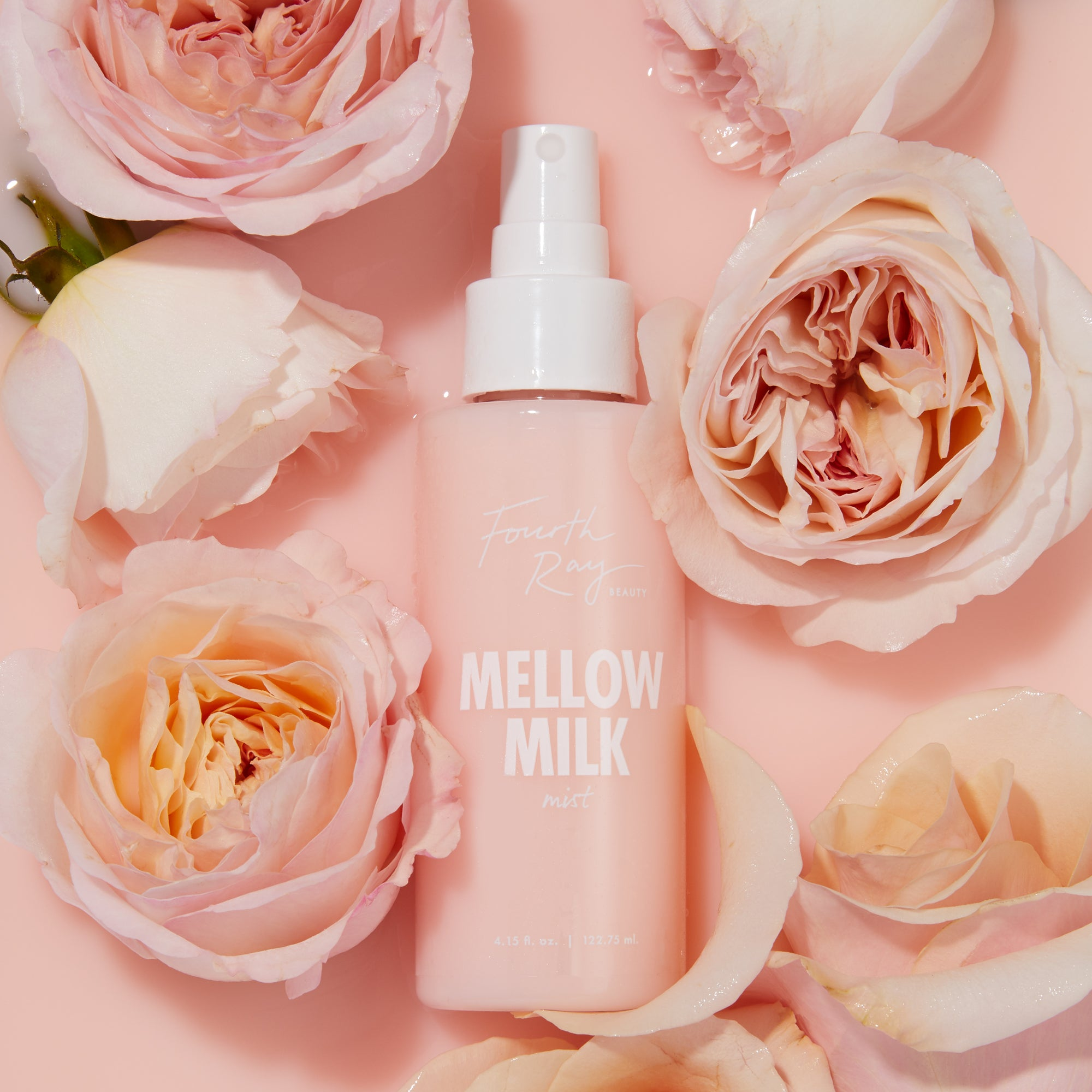 Mellow Milk Mist , floating in pink milk with pink roses