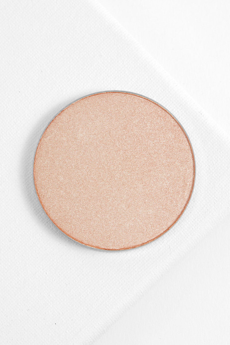 Padded Down pearlized warm champagne Pressed Powder Highlighter