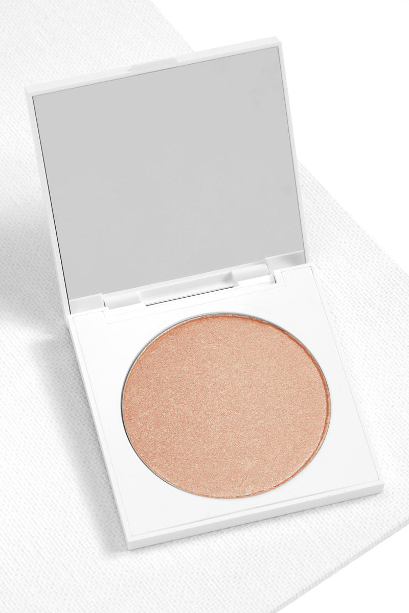 Padded Down pearlized warm champagne Pressed Powder Highlighter in compact