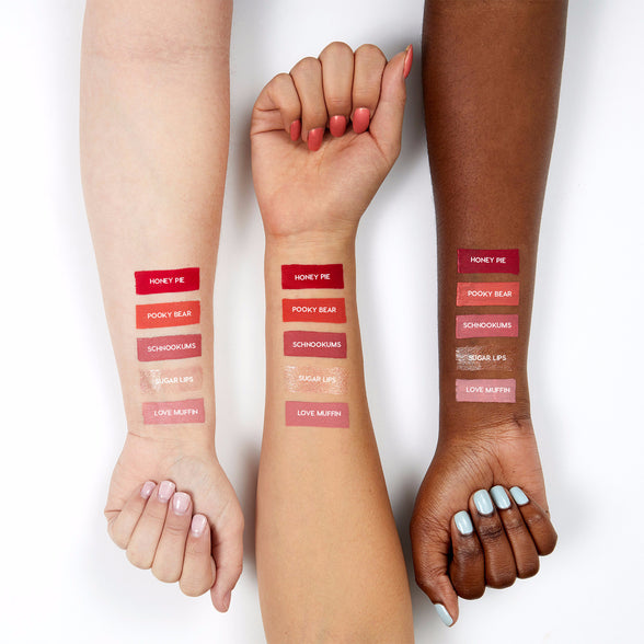 Short and Sweet includes Schnookums mid-tone warm rose Ultra Satin Lip, Love Muffin pastel baby pink Ultra Satin Lip, Honey Pie bright pinky red Ultra Matte Lip, Pooky Bear true coral Ultra Matte Lip, and Sugar Lips golden pink with gold, silver, copper, and hot pink glitter swatches