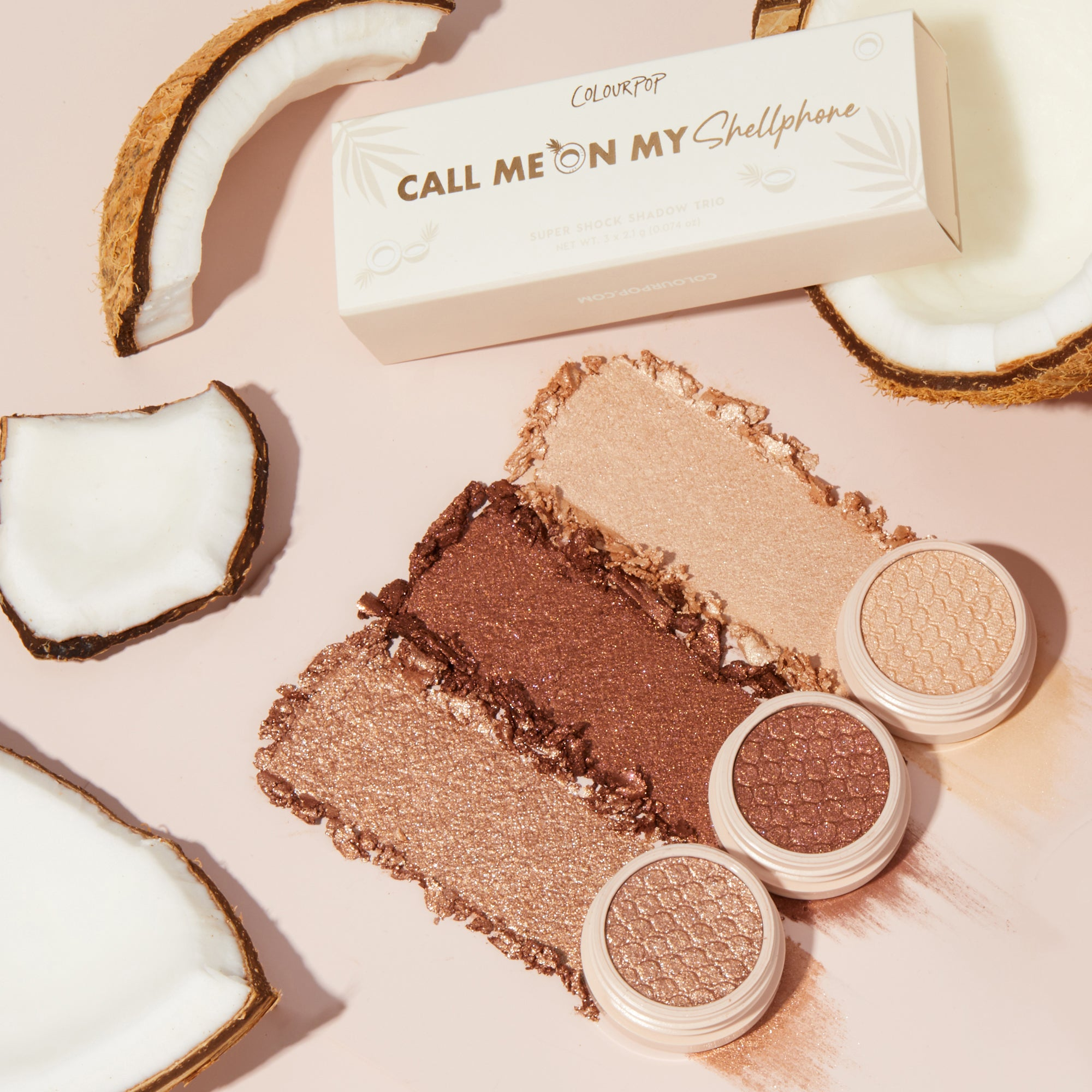 Call Me On My Shellphone bronzey super shock eyeshadow trio stylized photo with coconuts and products swatches