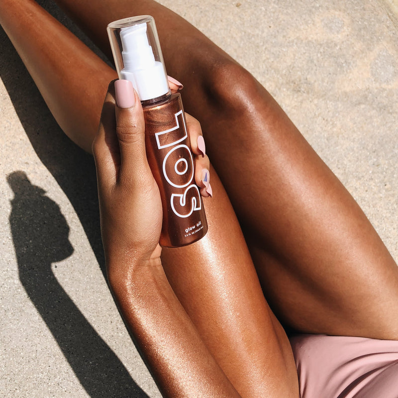 Caramel SOL Body Glow Oil rich copper with a golden sheen on model