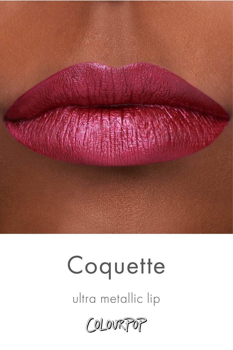 Coquette rich merlot red purple Ultra Metallic Lipstick swatch on deep skin