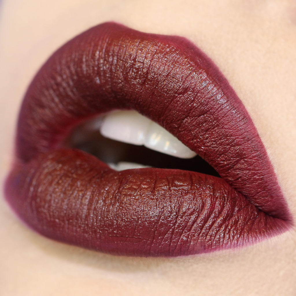 Creature deep burgundy matte Lippie Stix swatch