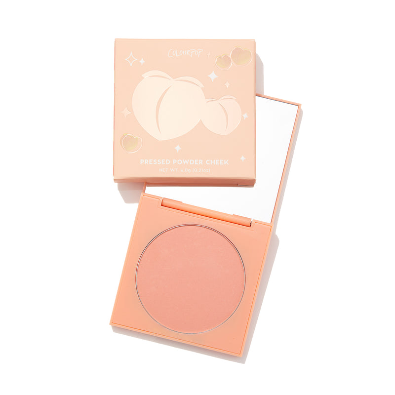 Frisky Business light peachy pink Pressed Powder Blush in compact