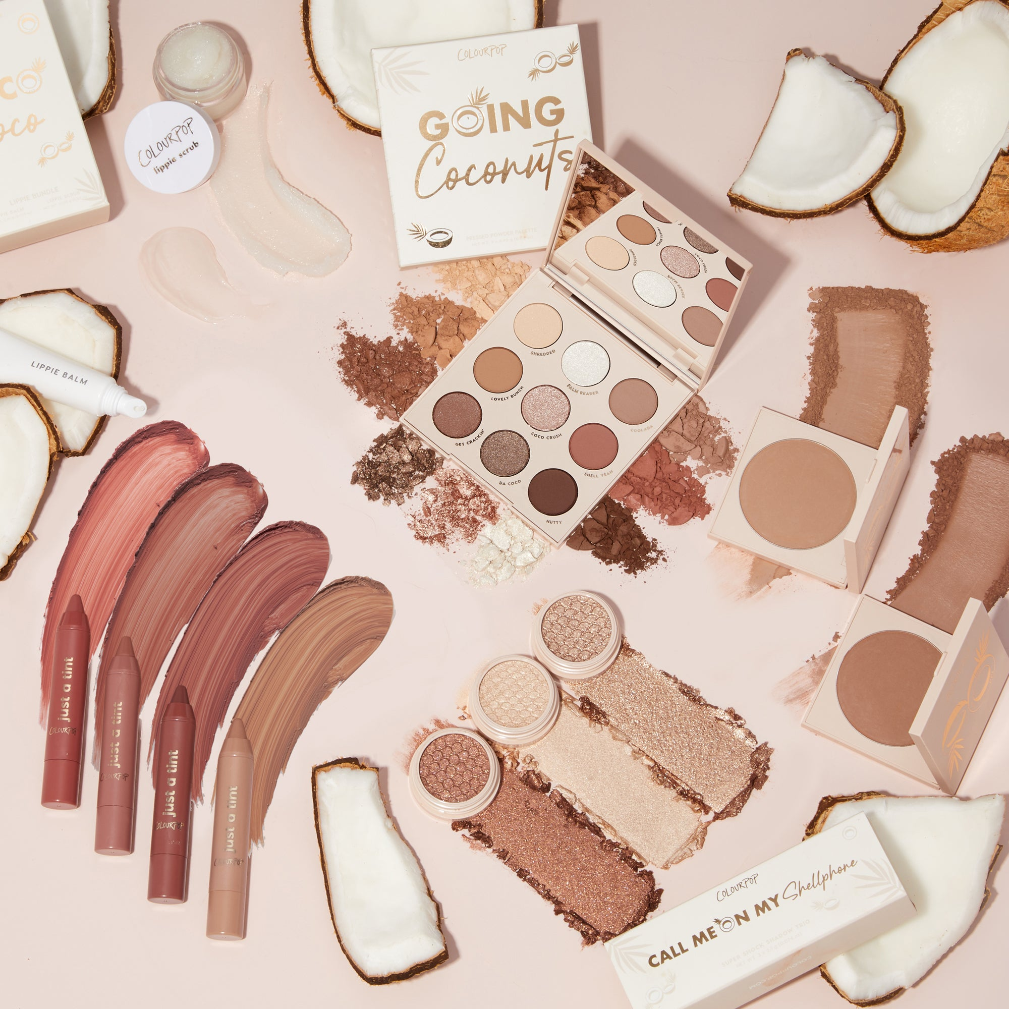 Going Coconuts Collection includes Bronzers, Lip Tints, Super Shock Eyeshadows, Lip Scrub, Lip Balm and a Cool-toned Eyeshadow Palette stylized photo with coconuts