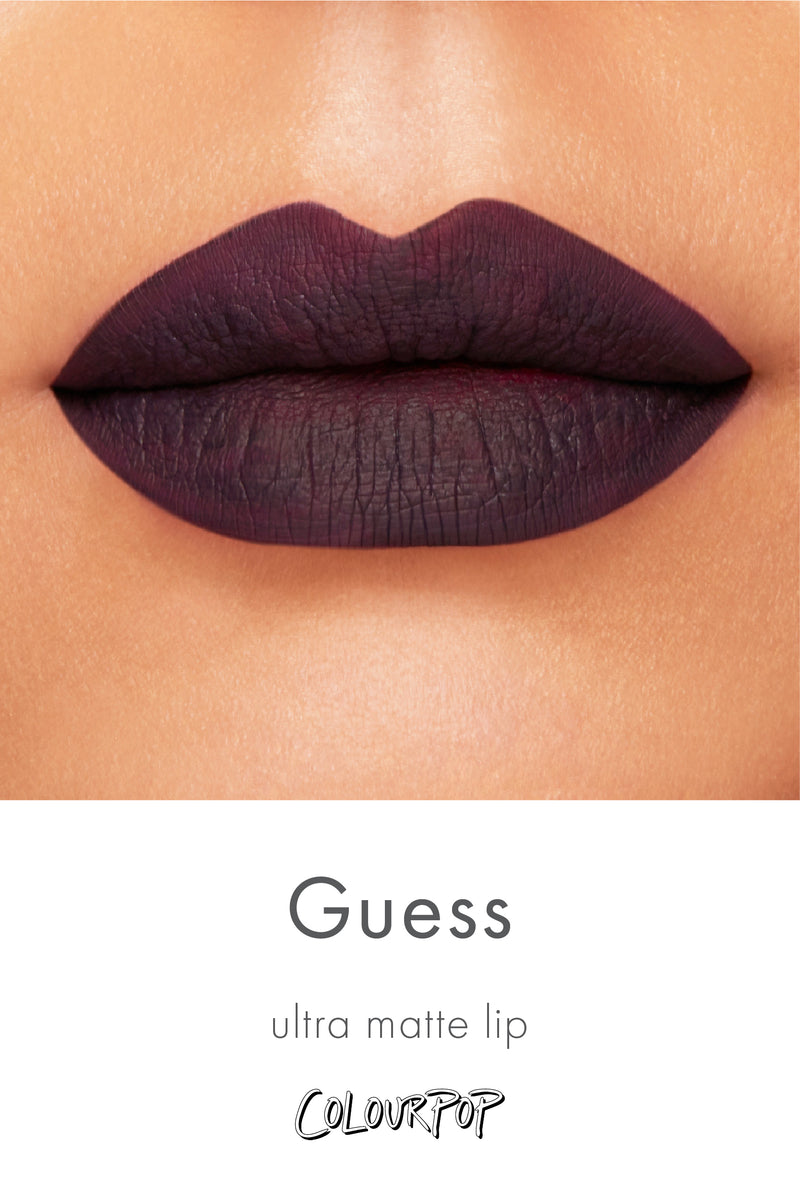 Guess blackened purple Ultra Matte Lipstick swatch on medium skin