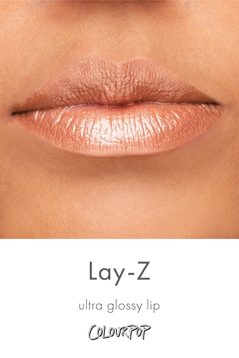 Lay-Z metallic nude with gold glitter Ultra Glossy lip gloss swatch on medium skin