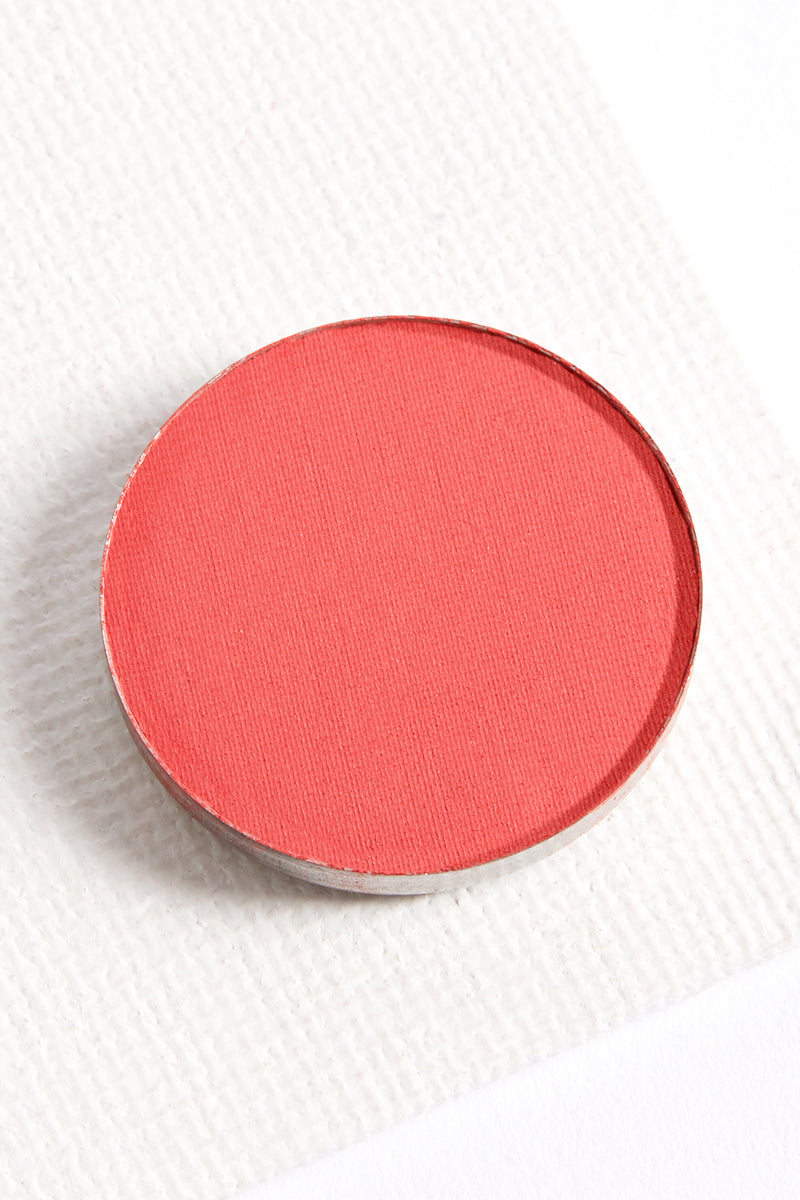 Making Moves matte red orange hot coral pressed powder eye shadow