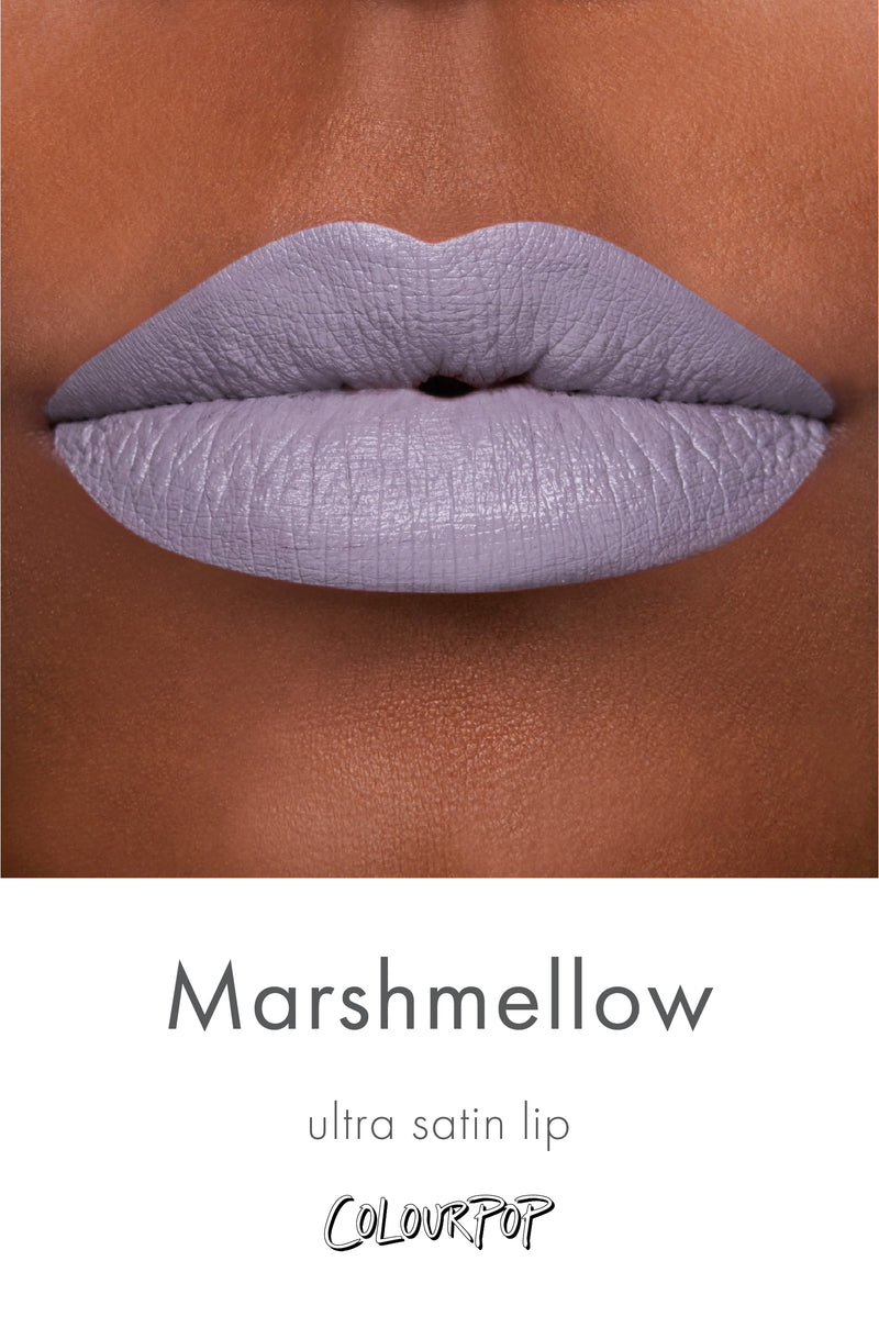 Marshmallow grey lavender Ultra Satin Lipstick swatch on deep skin