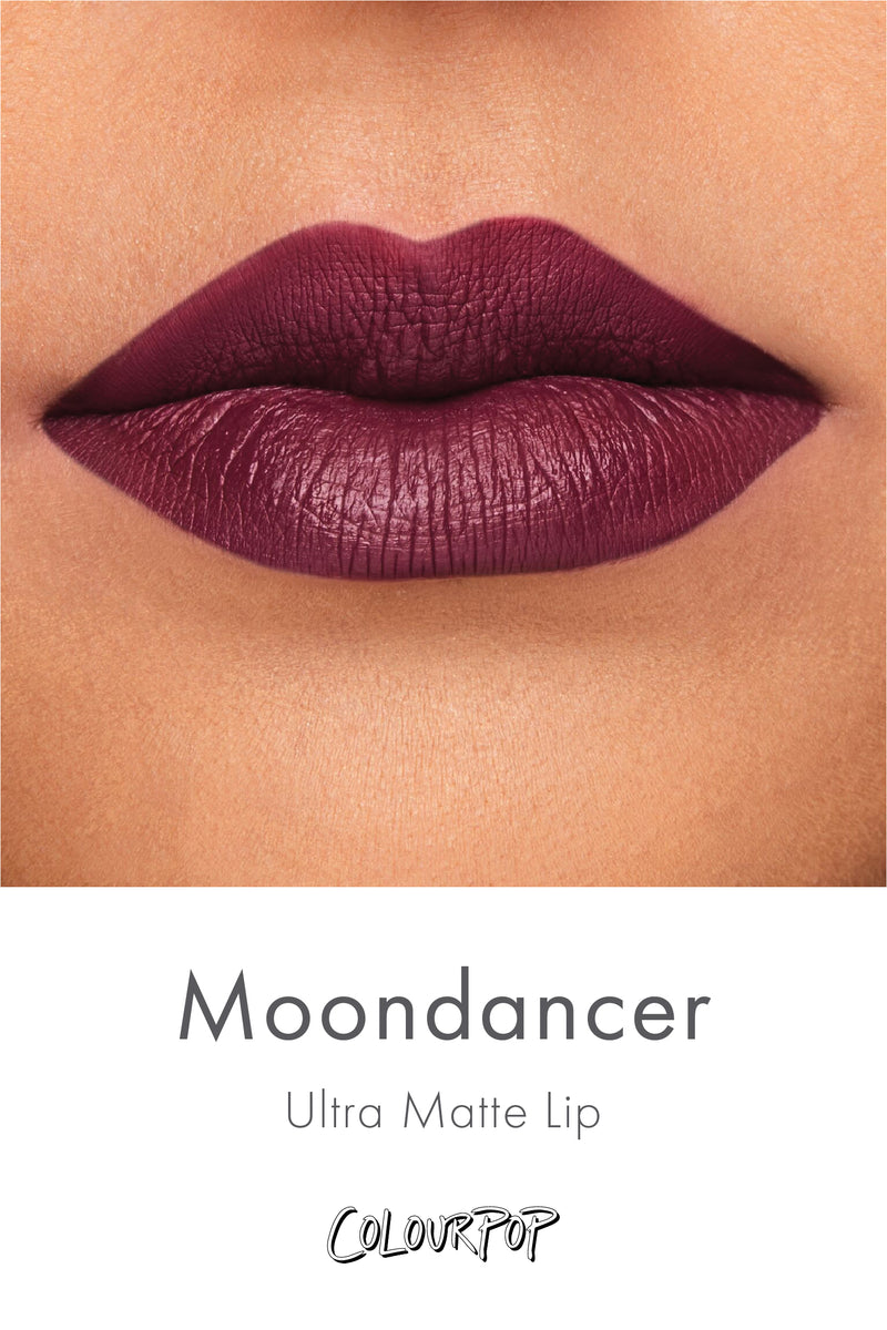 Moondancer blackened plum Ultra Matte liquid lipstick swatch on medium skin