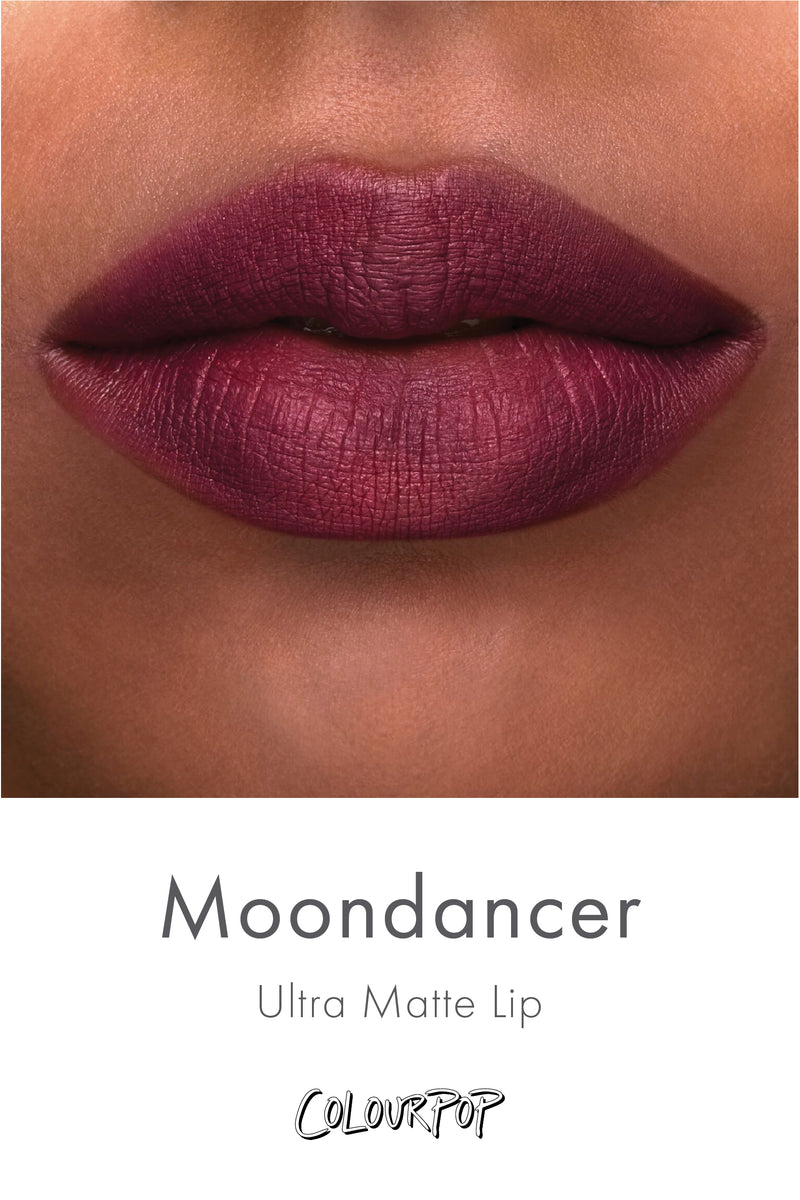 Moondancer blackened plum Ultra Matte liquid lipstick swatch on deep skin