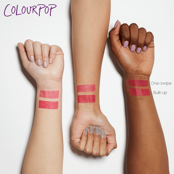 On a Stick sheer matte bright coral Blotted Lip arm swatches