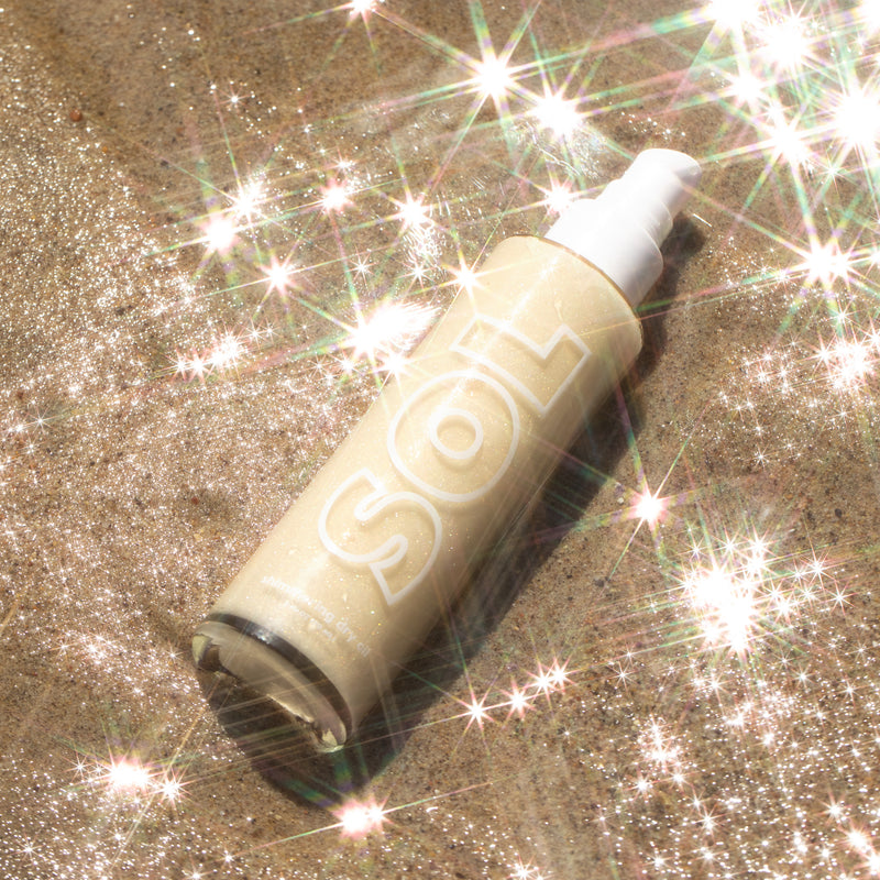 SOL Body Platinum Shimmering Dry Oil a shimmering ivory gold with highlights of silver and gold pearl