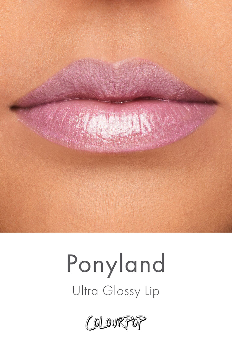 Ponyland Lilac slightly sprinkled with pink and gold glitter Ultra Glossy Lip gloss swatch on medium skin
