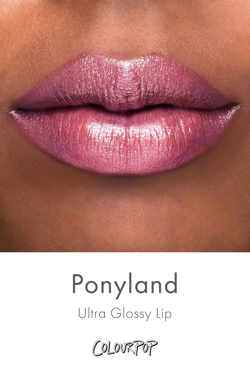 Ponyland Lilac slightly sprinkled with pink and gold glitter Ultra Glossy Lip gloss swatch on deep skin