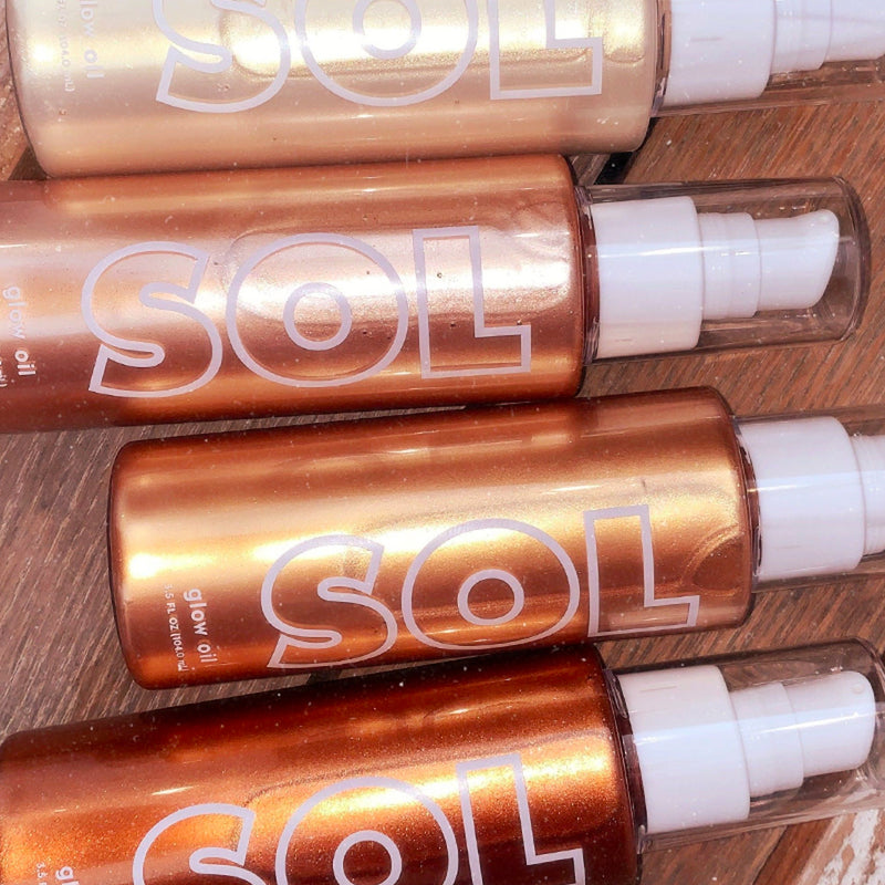 SOL Glow Oil Collection featuring our new 4 glow oil shades and the body kabuki brush