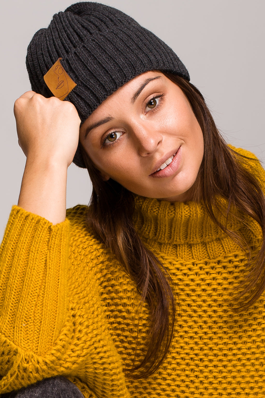 Graphite Knit Ribbed Beanie With A Faux Leather Badge - So Chic Boutique
