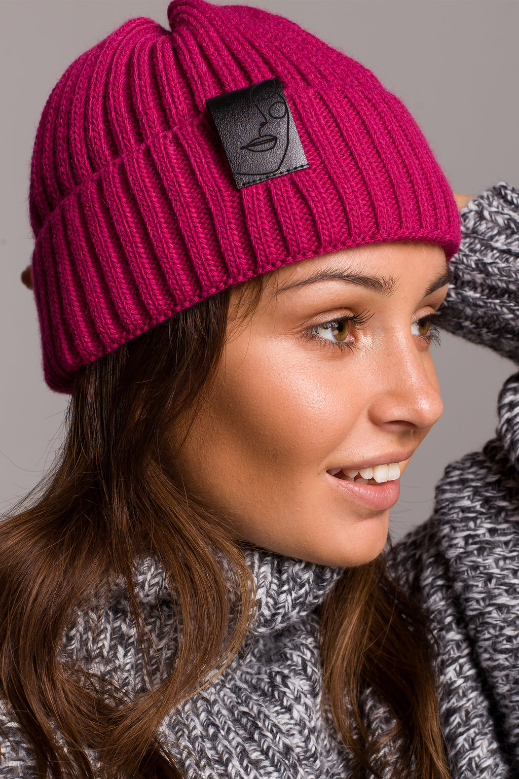 Raspberry Knit Ribbed Beanie With A Faux Leather Badge - So Chic Boutique