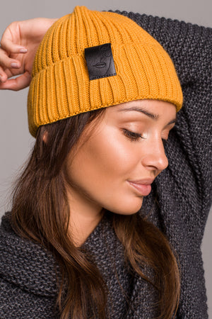 Mustard Knit Ribbed Beanie With A Faux Leather Badge - So Chic Boutique