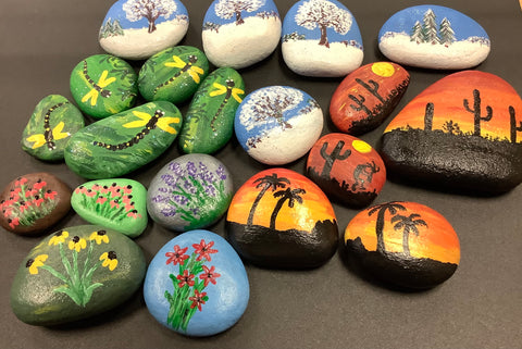 Various hand painted rocks