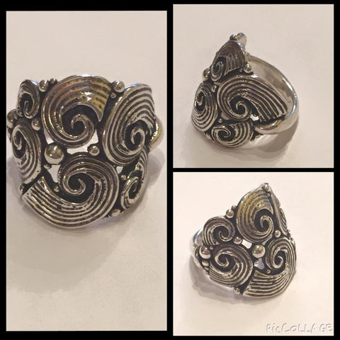 Handcrafted large sterling silver detailed ring.