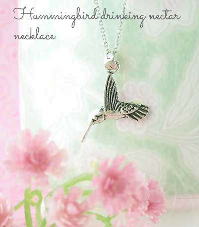 hummingbird drinking nectar necklace