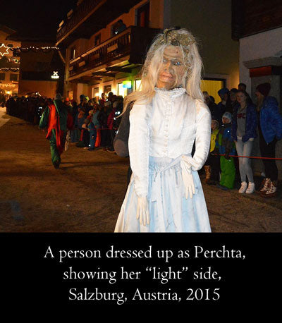 A person dressed up as Perchta, showing her light side. Salzburg, Austria, 2015