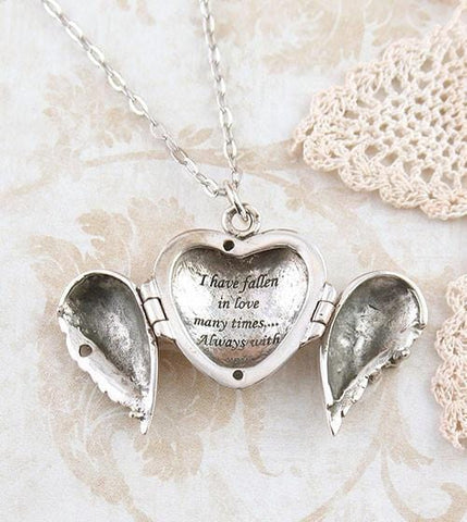 Angel wings heart locket necklace i have fallen in love many times angel wings heart locket necklace with message woot hammy aloadofball Choice Image