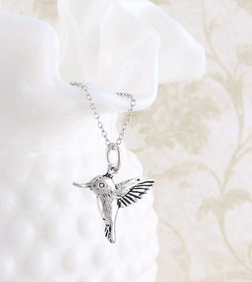 Tiny Hummingbird Pendant in Sterling Silver