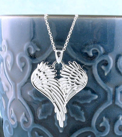 Peaceful Folded Angel Wings Necklace in Sterling Silver