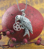 Raven Clutching a Pentacle Pendant