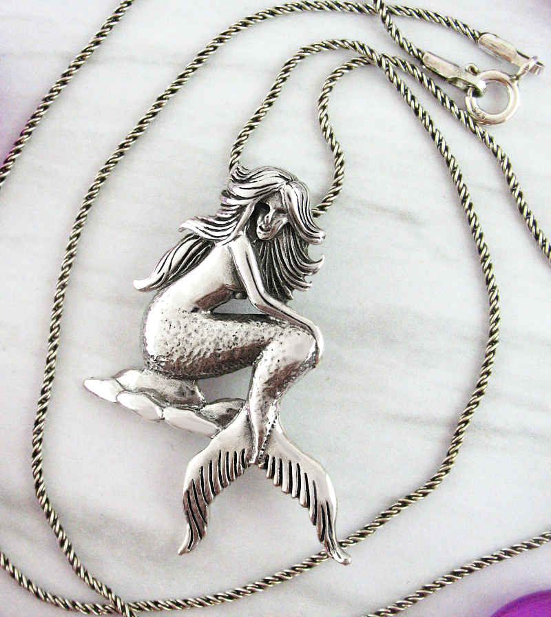 Picturesque Mermaid Sitting on Rocks Pendant | woot and hammy