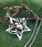 Long-Legged Spider Holding a Star Pendant Sterling Silver