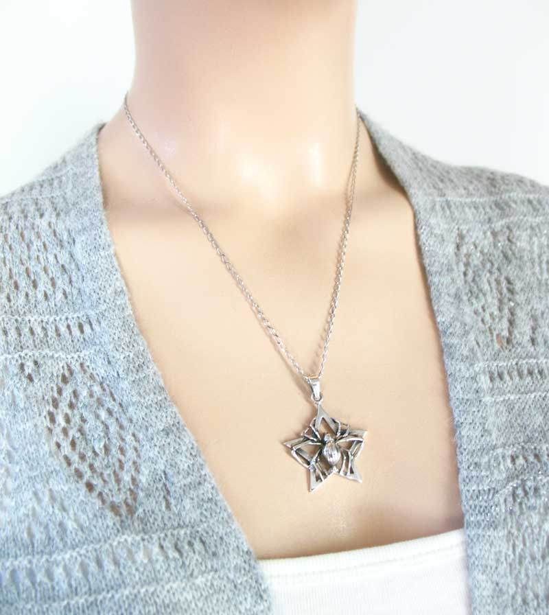 Long-Legged Spider Holding a Star Pendant