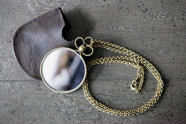 Mirror on a chain with leather pouch