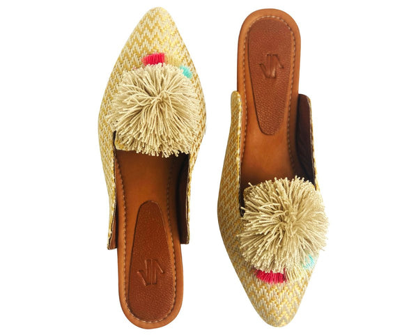 Embroidered flat mule with Pom Pom