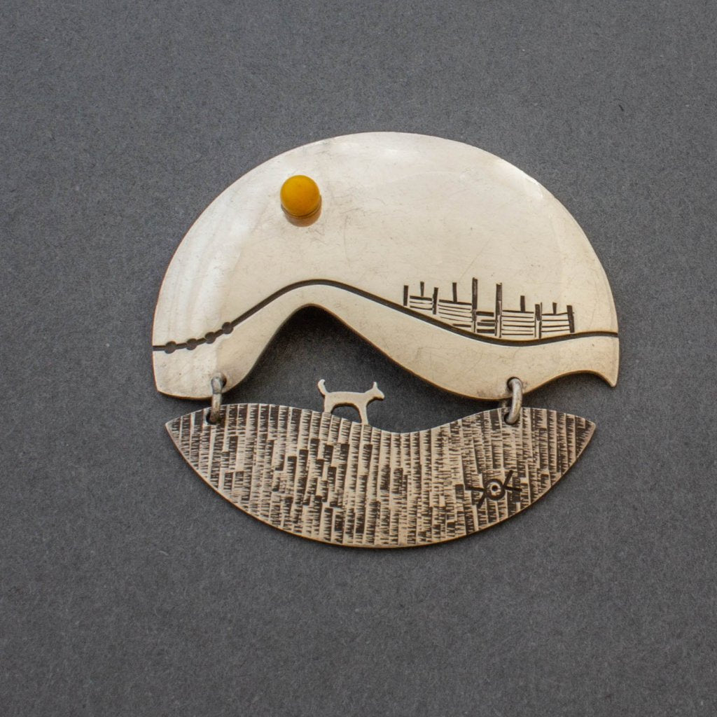 Silver Pin by Norbert Peshlakai of Happy Dog Under Yellow Sun